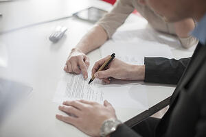clinician-signing-a-contract-600x400