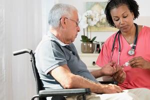 nurse caring for elderly patient